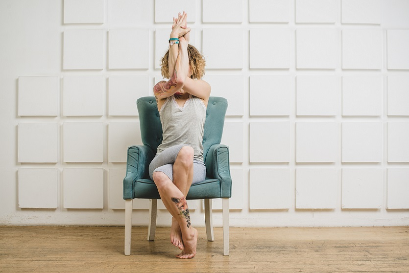 eagle arms yoga pose in a chair